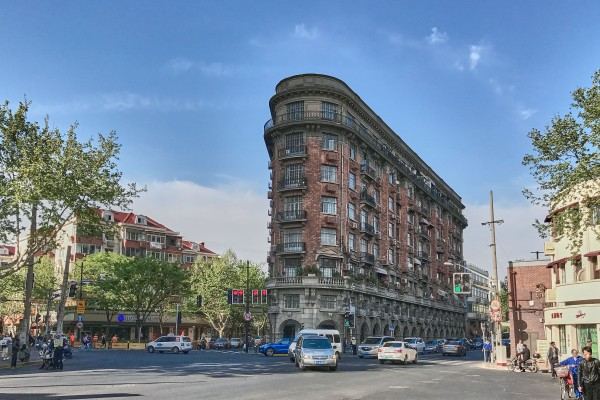 The Normandie Apartments (today's Wukang Mansion, 武康大楼, 1836–1858 Middle Huaihai Road) is located at a rare six-way intersection in the center of Shanghai, the junction of Shanghai Tianping Road (天平路), Yuqing Road (余庆路), Xingguo Road (兴国路), Wukang Road (武康路), and Huaihai Middle Road (淮海中路).