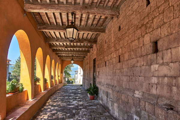 Arched walkway in Serravalle, Tuscany summer itinerary