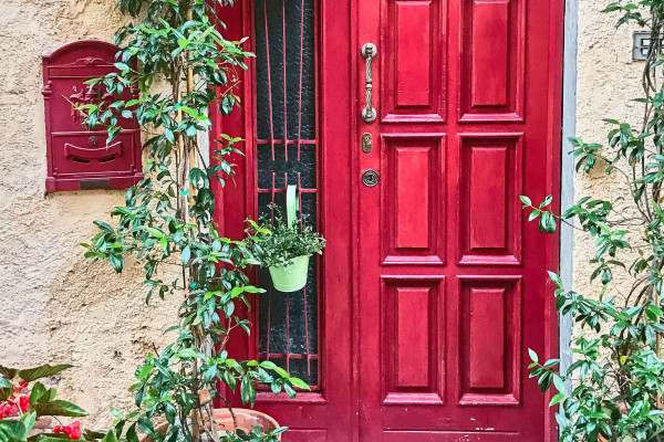 House door decorated with flower pots, Monteggiori, Tuscany