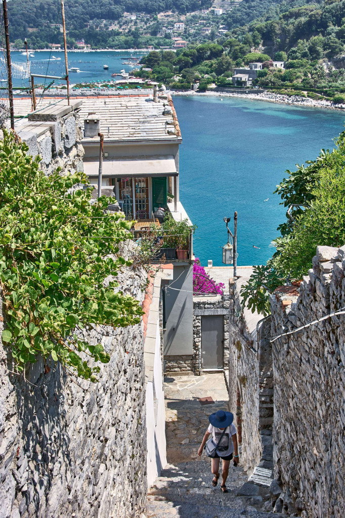 A narrow steep staircases that lead down the hill from the Doria Castle