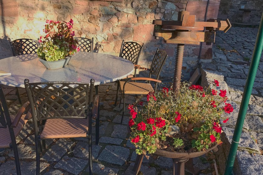A charming sitting corner in the courtyard of the Windeck Castle, Weinheim; day trip from Frankfurt