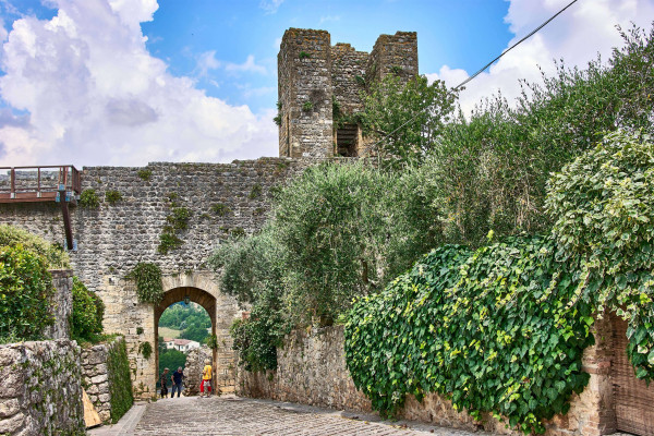 Old walls of the medieval walled village Monteriggioni, Italy; Day trips from Pisa