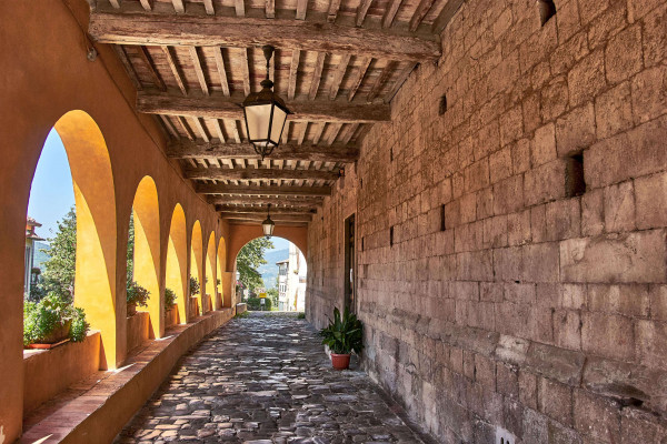 Arched walkway in Serravalle Pistoiese; Day trips from Pisa,