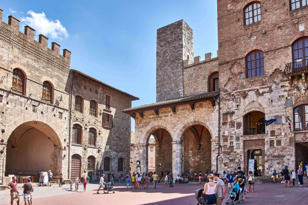Piazza Duomo in San Gimignano, Tuscany; Day trips from Pisa