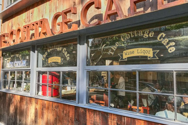 Cottage Cafe & Bar (老麦咖啡馆) on the ground floor of the Normandie Apartments in Shanghai