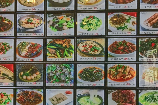 foods and prices displayed on a big wall