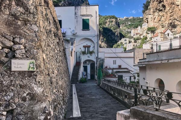 The narrow street meets the Via San Sebastiano, which extends to Via Torricella.