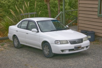 Rent a Car in New Zealand Things You Should Expect; An old Nissan with nearly 300,000 km