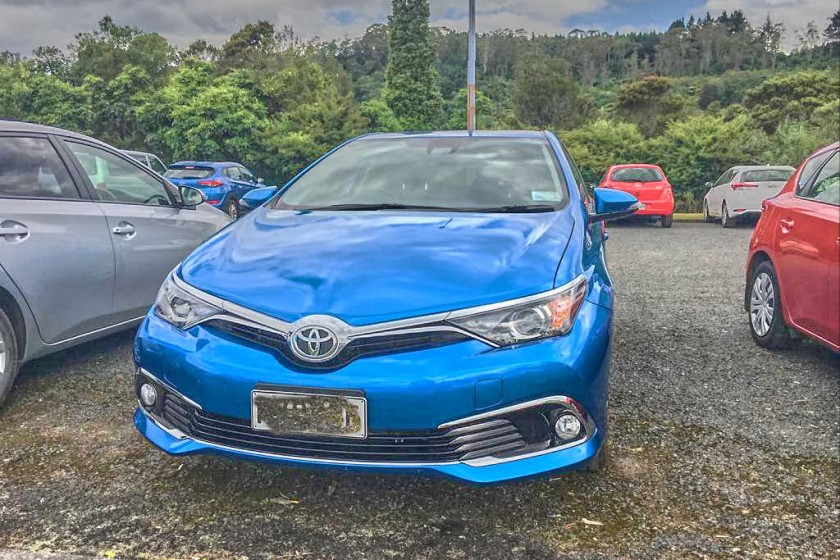 a brand new blue Toyota; Rent a Car in New Zealand Things You Should Expect
