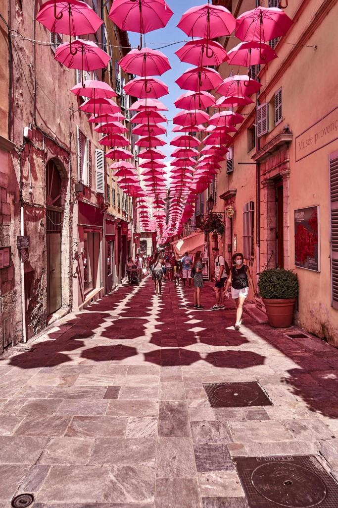 an art installation of pink umbrellas