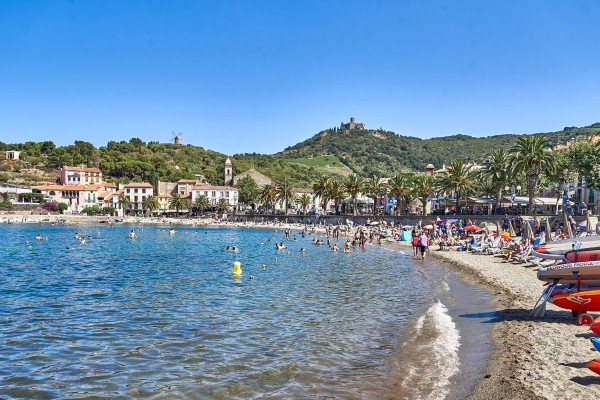 View of the Oil Windmill and Chateau from the beach in Collioure Fishing Village