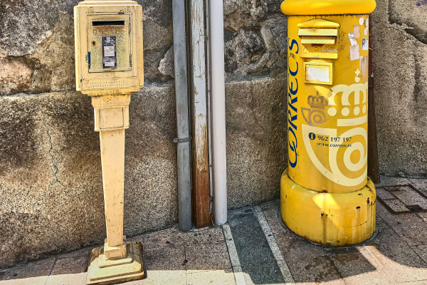 two post boxes, one from Spanish system and the other from French system