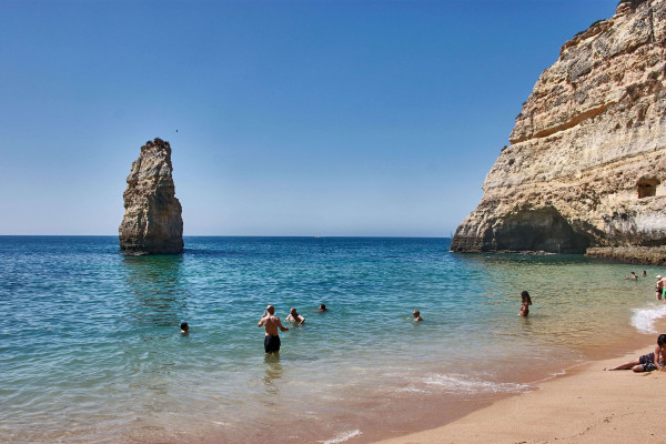 A big rock in the water of Praia do Carvalho; Portugal