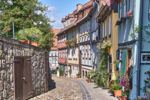 The small street parallel to the hill consists of many half-timbered houses, colourful painted and beautifully decorated; The Old Town of Quedlinburg